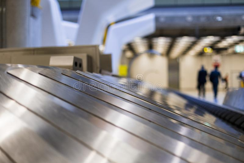empty conveyor belt at the airport.blurred passengers in the background. travel concept royalty free stock images