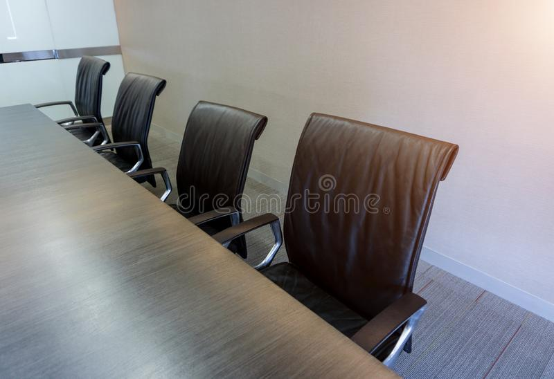 Empty corporate chair in conference room before business meeting stock image