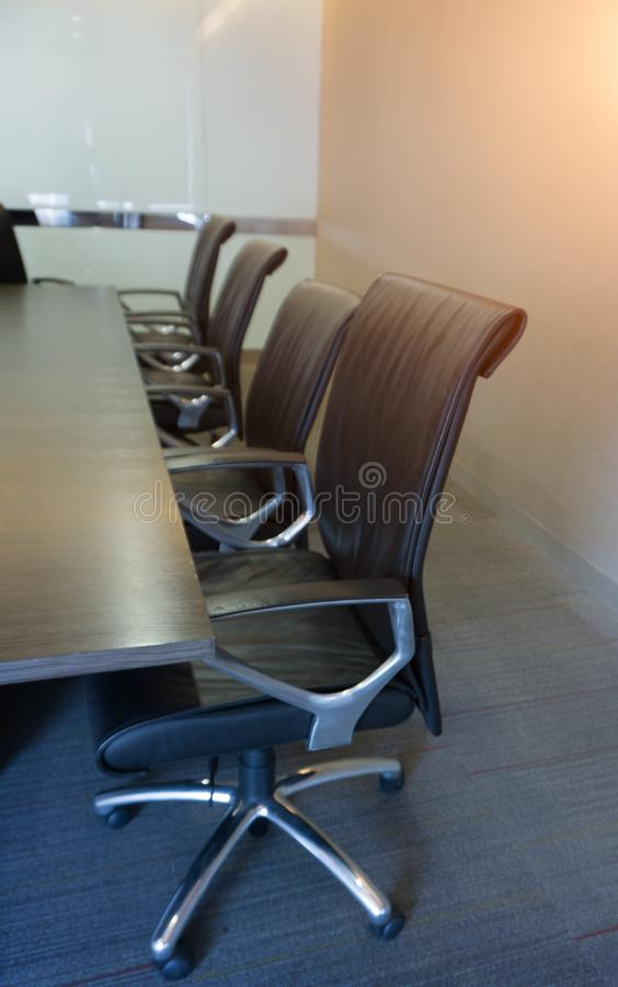 Empty corporate chair in conference room before business meeting. Four Empty corporate chair in conference room before business meeting royalty free stock photography