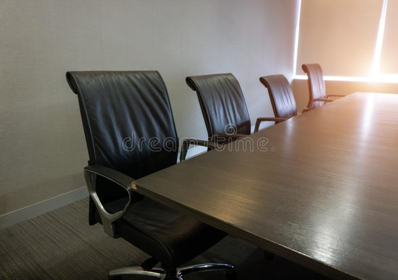 Empty corporate chair in conference room before business meeting stock photos