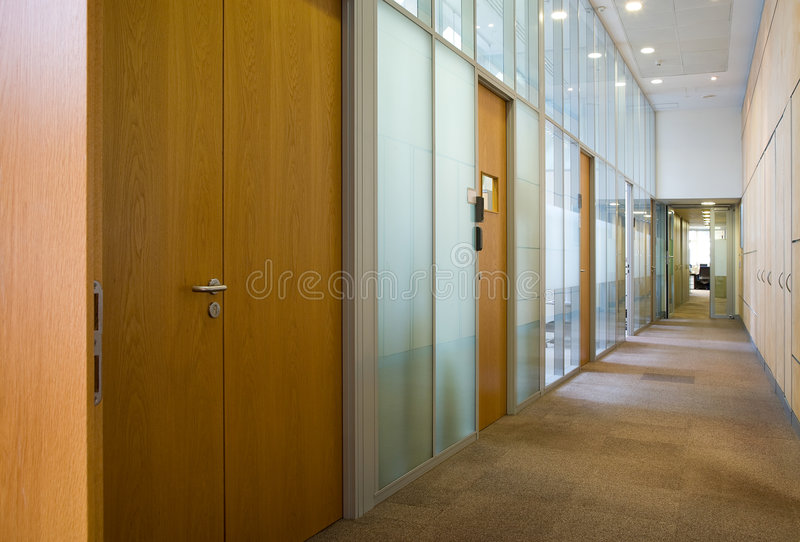 Empty corridor. With set of doors and lamps on a ceiling stock image