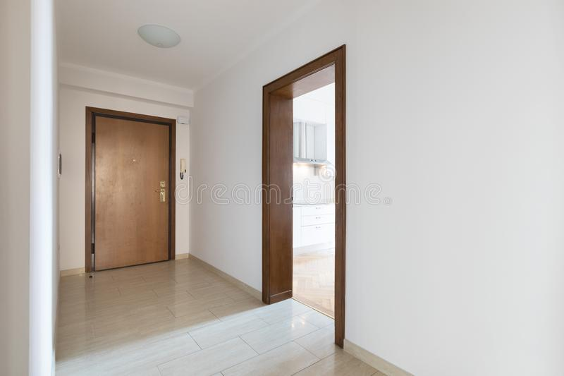 Empty corridor, clean white walls after renovation. Empty entrance, clean white walls stock image