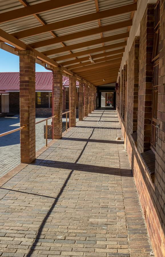 Empty corridor in a school courtyard royalty free stock image