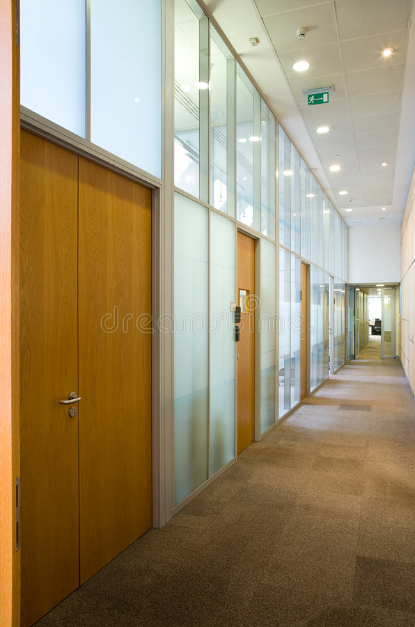 Empty corridor with set of doors. And lamps on a ceiling stock image