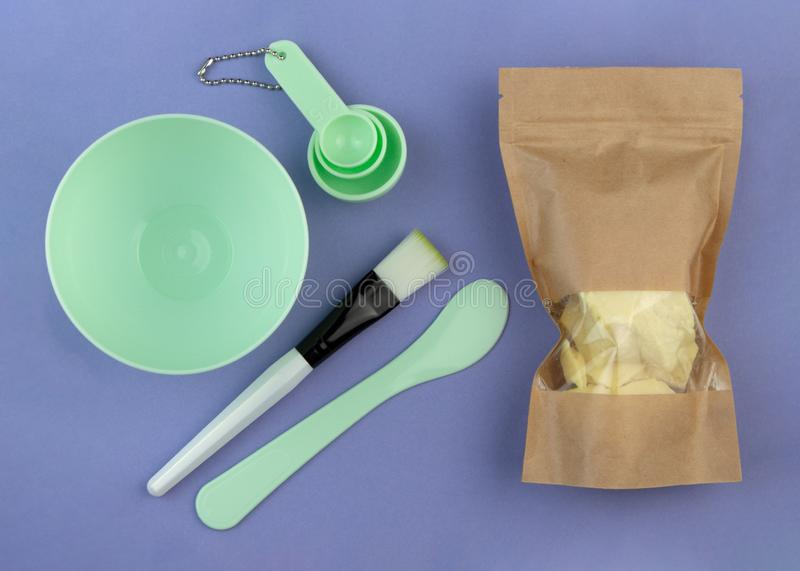 Empty cosmetic kit for making homemade face masks and cocoa butter in kraft paper bag stock images