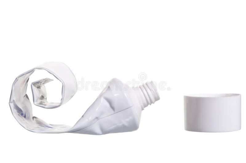 Empty cosmetic tube with the lid open royalty free stock photo