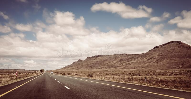 Empty country highway road in South African Karoo region. View of an empty country highway road in South African Karoo region stock photos