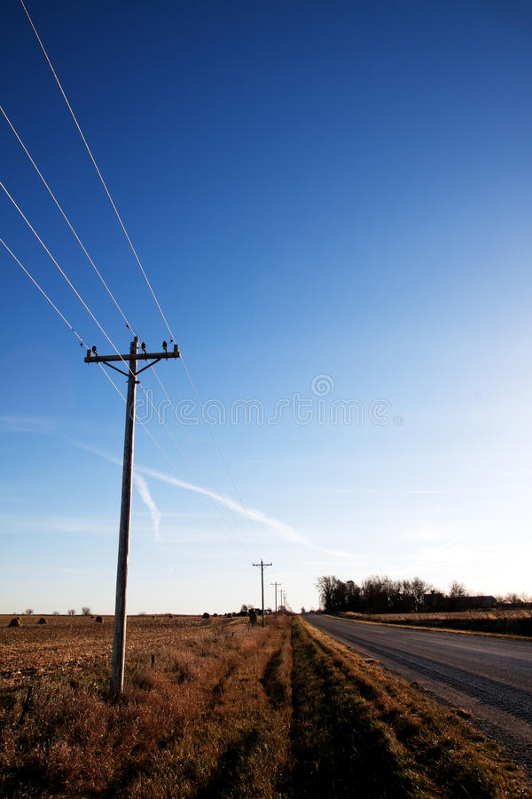 Empty country road in autumn stock photography
