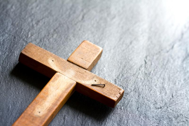 Empty cross with shadow of Jesus Christ abstract resurrection easter background concept. Closeup stock photos