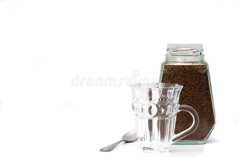 Empty crystal coffee mugs, coffee spoons and coffee in a glass bottle stock photo