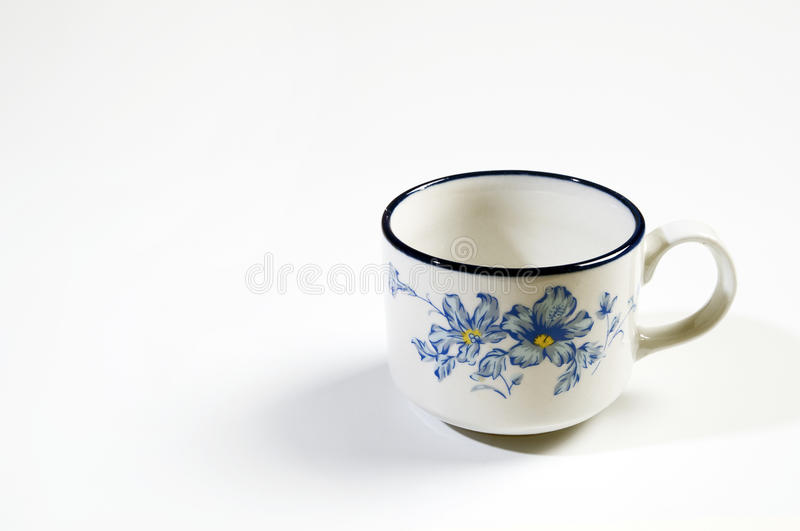 Empty Cup. In white background royalty free stock photo