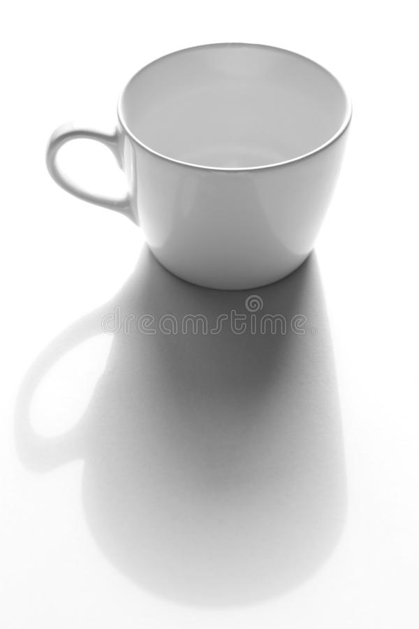 Empty cup. Of coffee on the grey paper royalty free stock photo