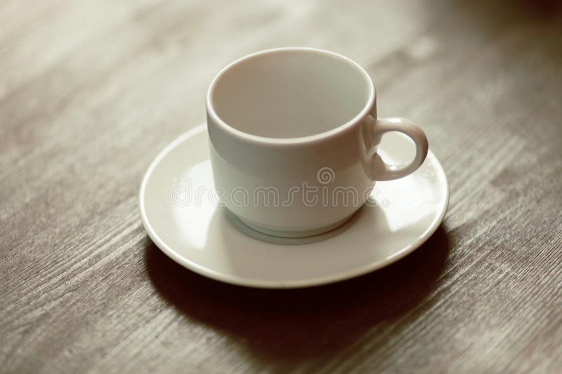 Empty cup on the table royalty free stock photo