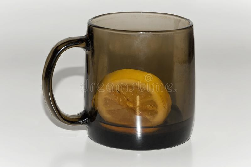 Almost empty cup of tea with lemon royalty free stock photo
