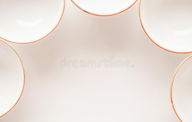 Empty cup on white table. Minimalistic objects background royalty free stock photography