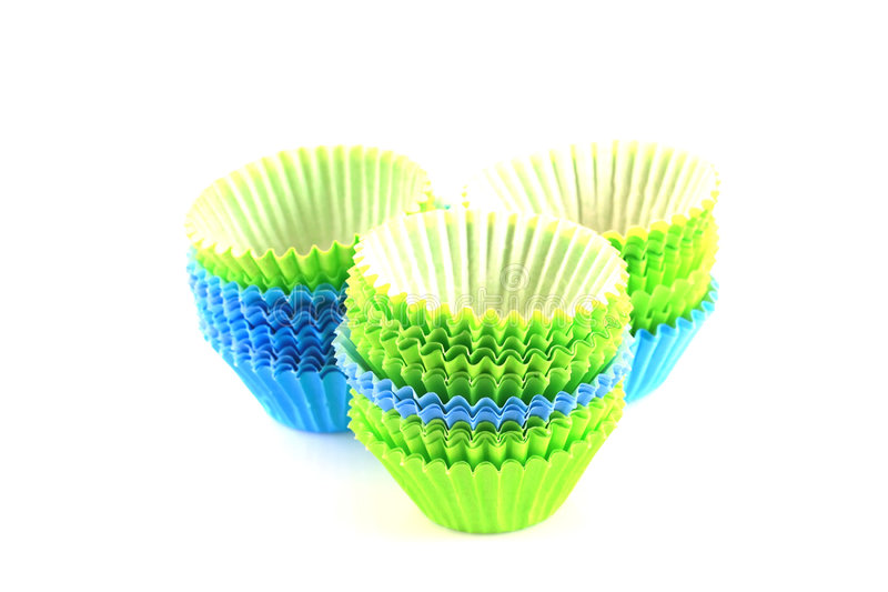 Empty cupcake cups in green and blue stock image