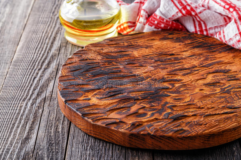Empty cutting board- concept of cooking. royalty free stock image