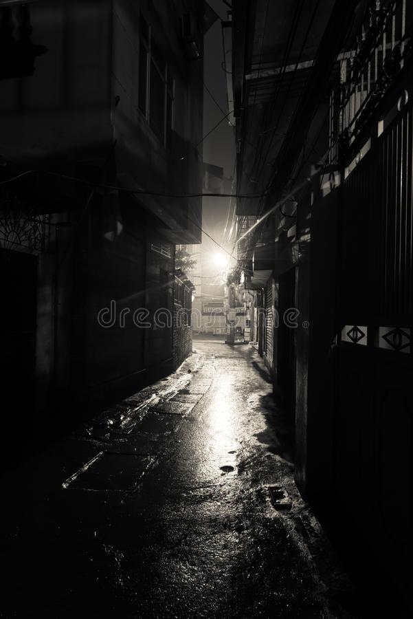 Empty and dangerous looking urban back-alley at night time in suburbs Hanoi stock photography