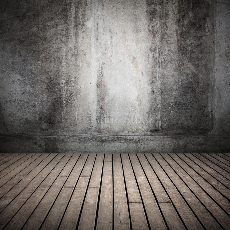 Empty dark abstract old interior background. Empty dark abstract interior background with old concrete wall and wooden floor royalty free stock photos