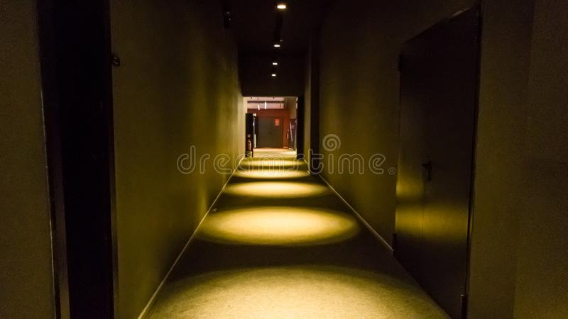 Empty dark corridor in apartment building in perspective view with copy space. stock images