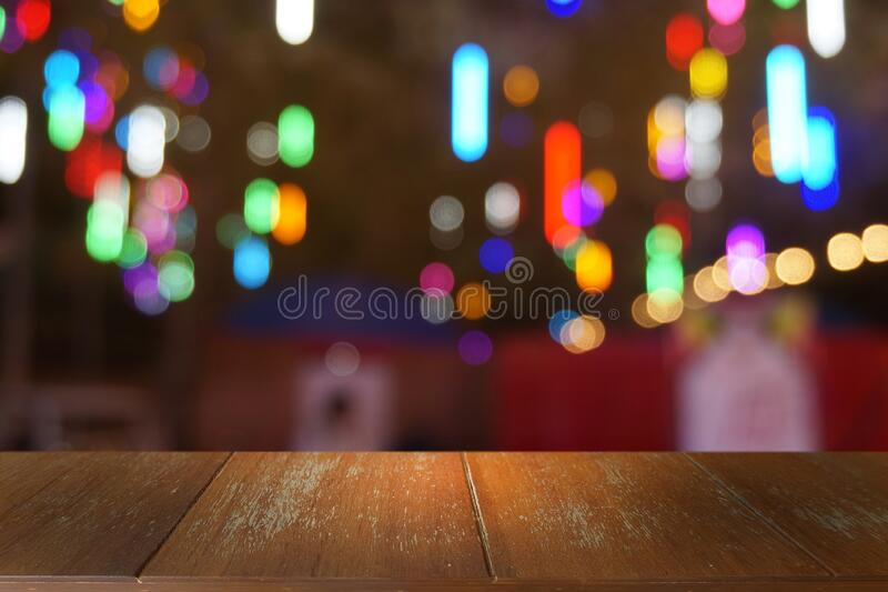 Empty dark wooden table in front of abstract blurred bokeh background of restaurant. stock images