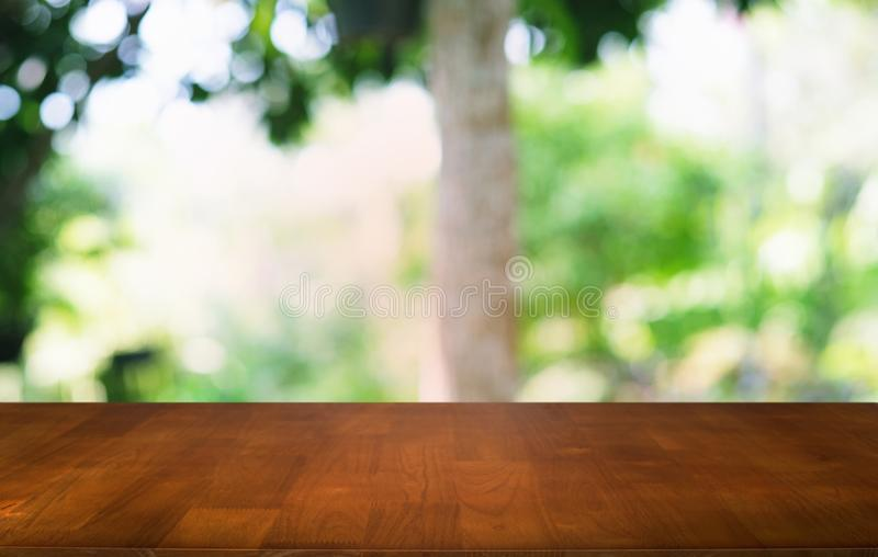 Empty dark wooden table in front of abstract blurred bokeh background of restaurant . can be used for display or montage your royalty free stock photo