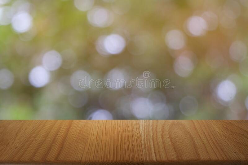 Empty dark wooden table in front of abstract blurred bokeh background of restaurant. royalty free stock photos