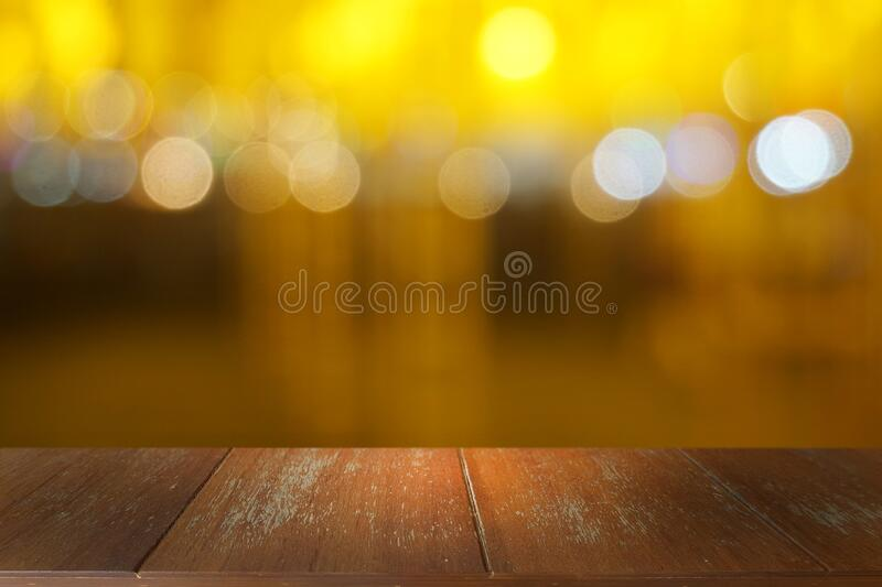 Empty dark wooden table in front of abstract blurred bokeh background of restaurant. stock photos