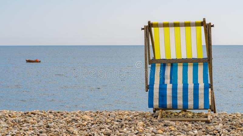 Empty Deck chair , Beer, Devon, UK royalty free stock images