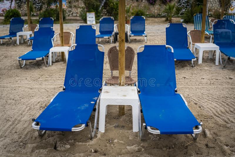 Empty deckchairs on a beach in greece stock photos