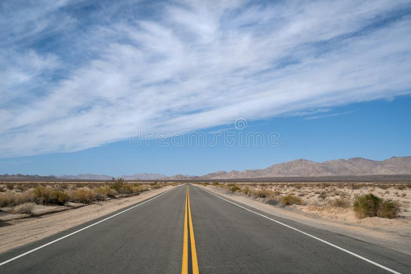 Empty Desert Highway running from California to Arizona stock photo