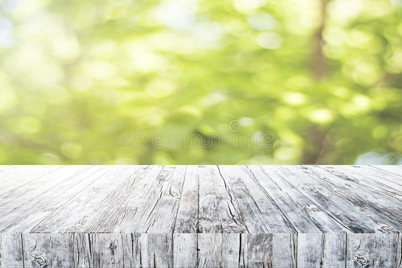Empty desk on green background stock image