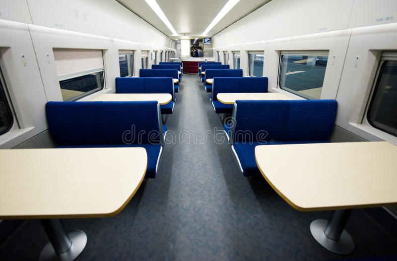 Empty dining car on train royalty free stock image