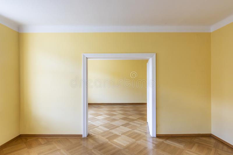 Empty dining or dancing room of an old vintage house with wooden parket royalty free stock photo