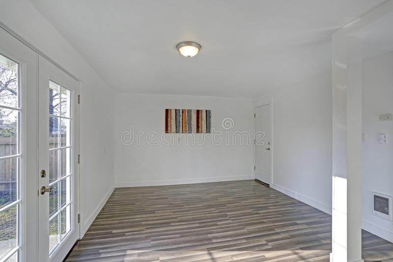 Empty dining room. Pure white walls make the room spacious royalty free stock image