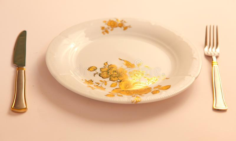 Empty Dish with Fork and knife stock photos