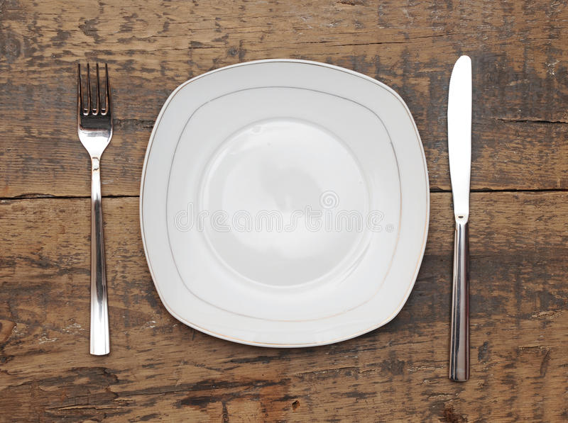 Download Empty dish, knife and fork stock photo. Image of place - 24111530