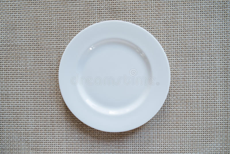 Empty dish on the paper stock image
