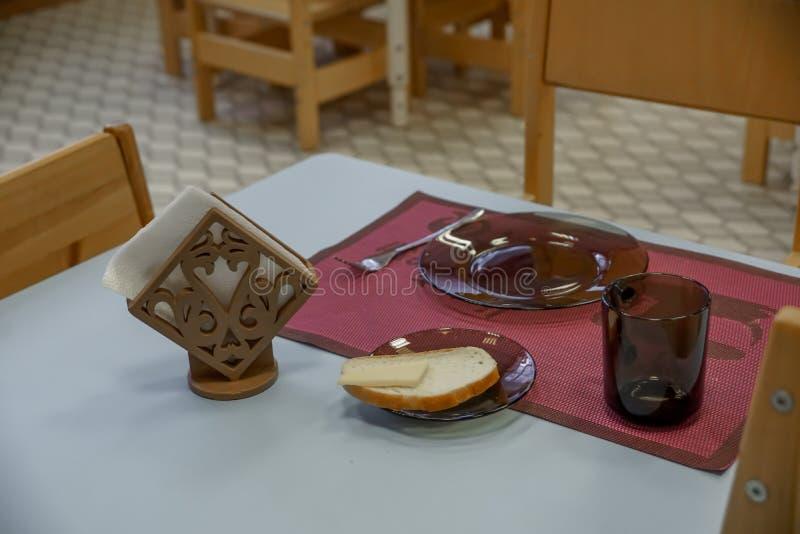 Empty dishes set for breakfast in kindergarden. Kindergarten indoor view. Furniture. stock image