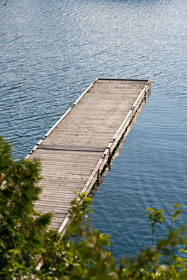 Download An Empty Dock Extending Into The Water Stock Photo - Image: 10792122
