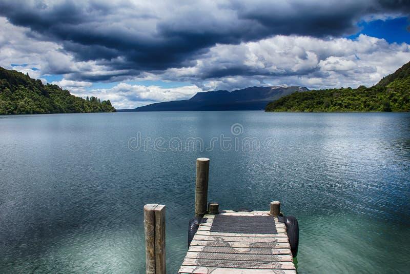 Empty dock in lake landscape stock photography