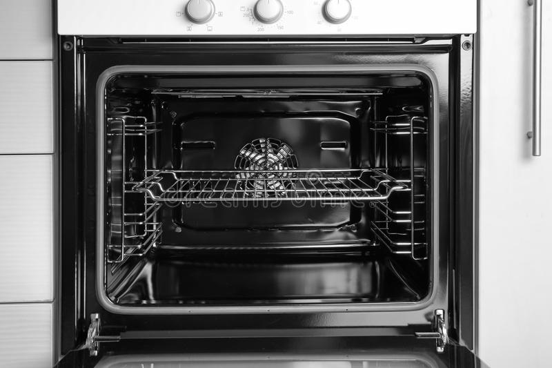 Empty electric oven in kitchen royalty free stock photos