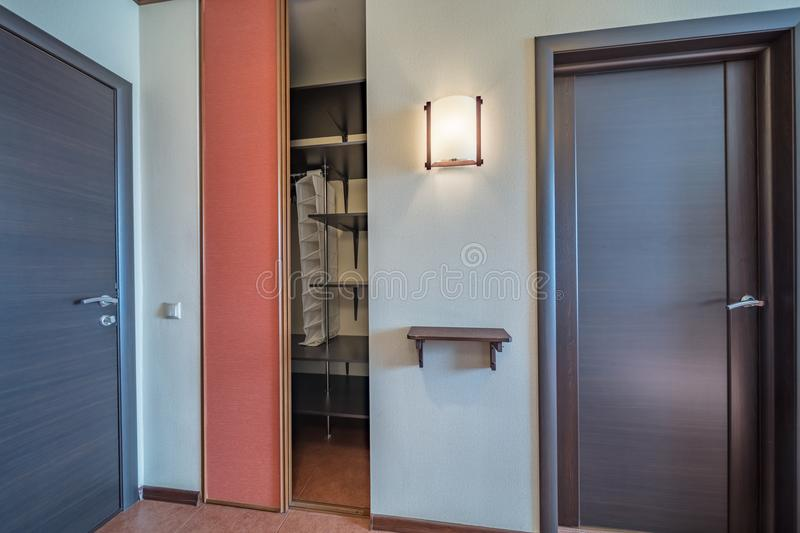 Empty bright entrance. Empty entrance in modern apartment with wardrobe royalty free stock photography