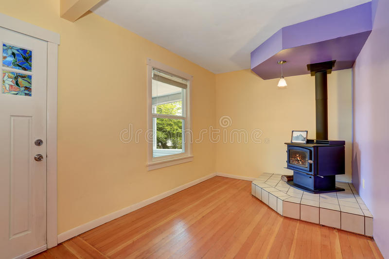 Empty entrance room with Vintage fireplace in the corner royalty free stock photography