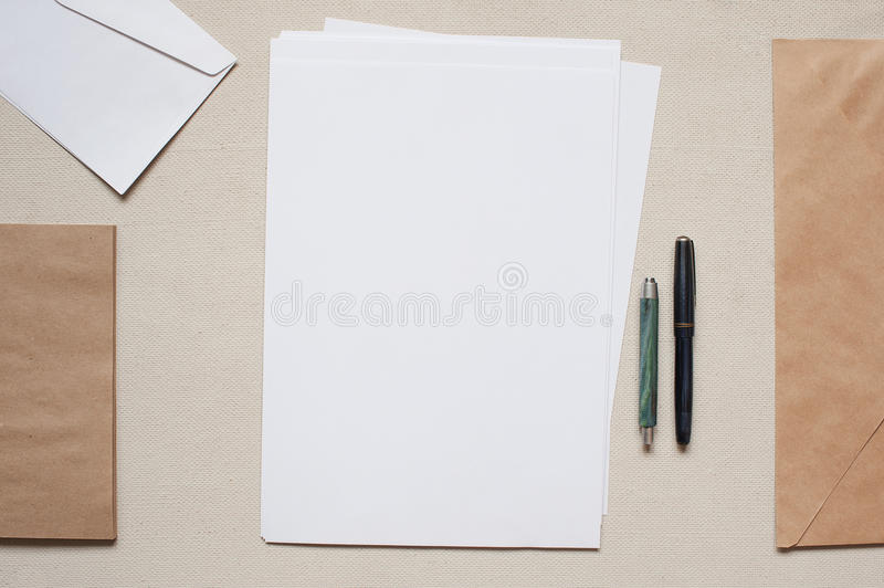 Empty envelopes and sheets of paper on the table. Empty envelopes and sheets of paper on the old table royalty free stock image