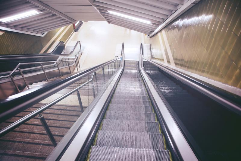 Empty escalator and stair in pedestrian subway railway station. Stairs from metro underground upward. travel concept. Europe royalty free stock photography