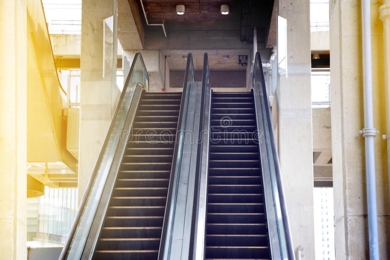 Empty escalator stairs in public building. Escalator,Up and down escalators in public building. conveying people between the floors of a public building stock images