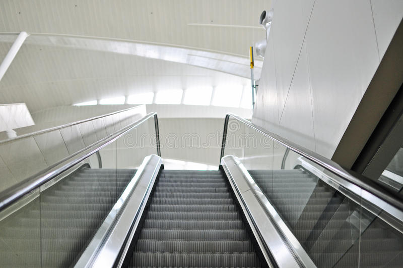 Empty escalator stairs in the Terminal royalty free stock image
