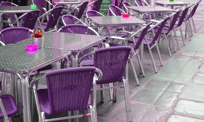 Empty European street cafe with purple chairs and tables, selective focus royalty free stock images