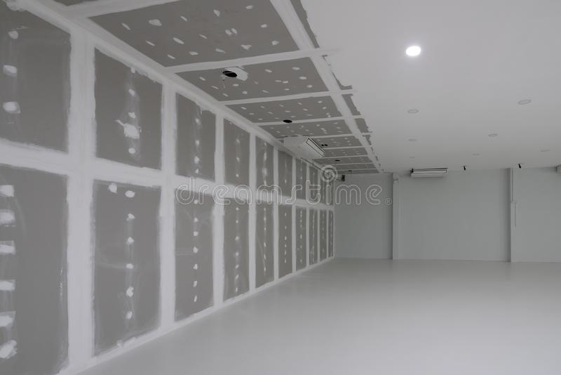 Empty factory during decorate interior, warehouse interior with down light. stock photos